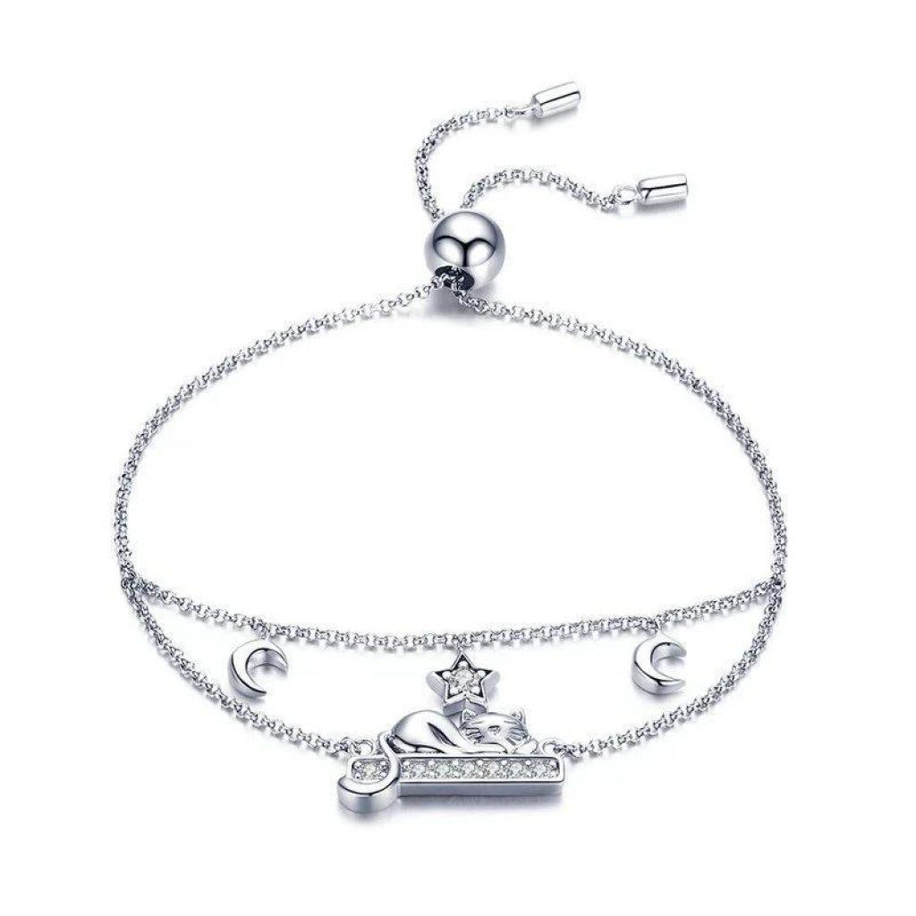 Bracelet en argent et cristaux de zirconium, chat endormi à la belle étoile